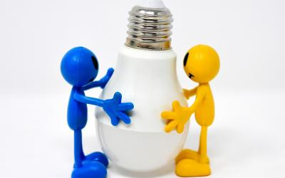 two figures hold an LED lightbulb together